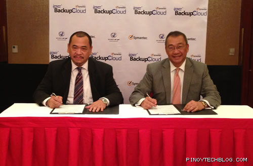 Luichi Robles, Symantec's Senior Country Manager and IP-Converge President Reynaldo R. Huergas seals partnership for IPC BackupCloud